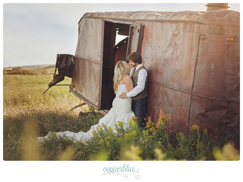 Bride and groom with abandoned train