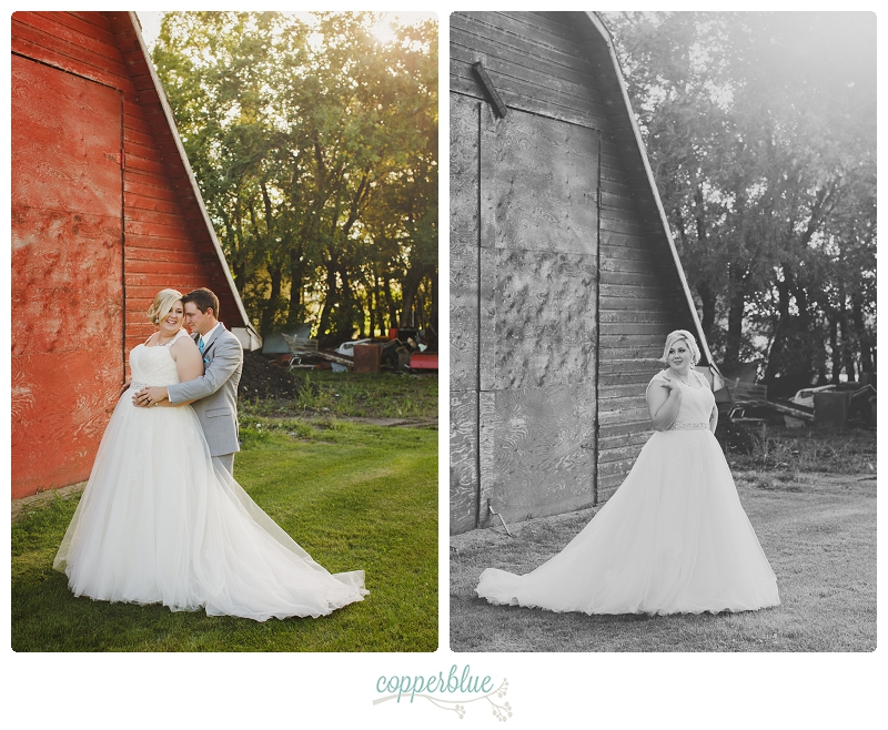 Bride and groom with red barn