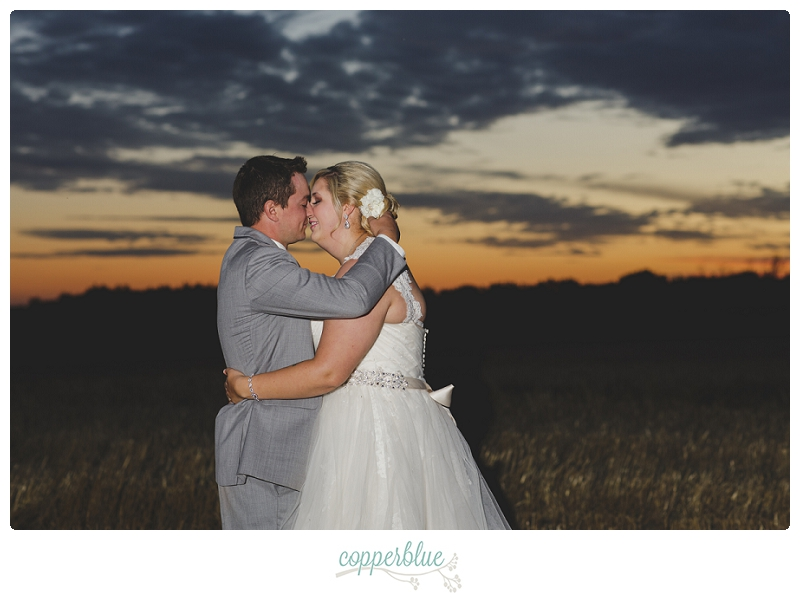 Bride and groom with Saskatchewan sunset